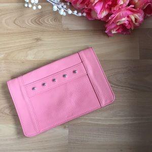 BCBG sherbet pink Quinn studded front strap clutch